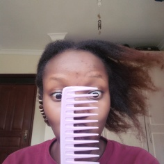 Going in with a wide-toothed comb to detangle my hair